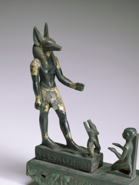 egyptian_-_a_worshipper_kneeling_before_the_god_anubis_-_walters_54400_-_three_quarter_view.jpg